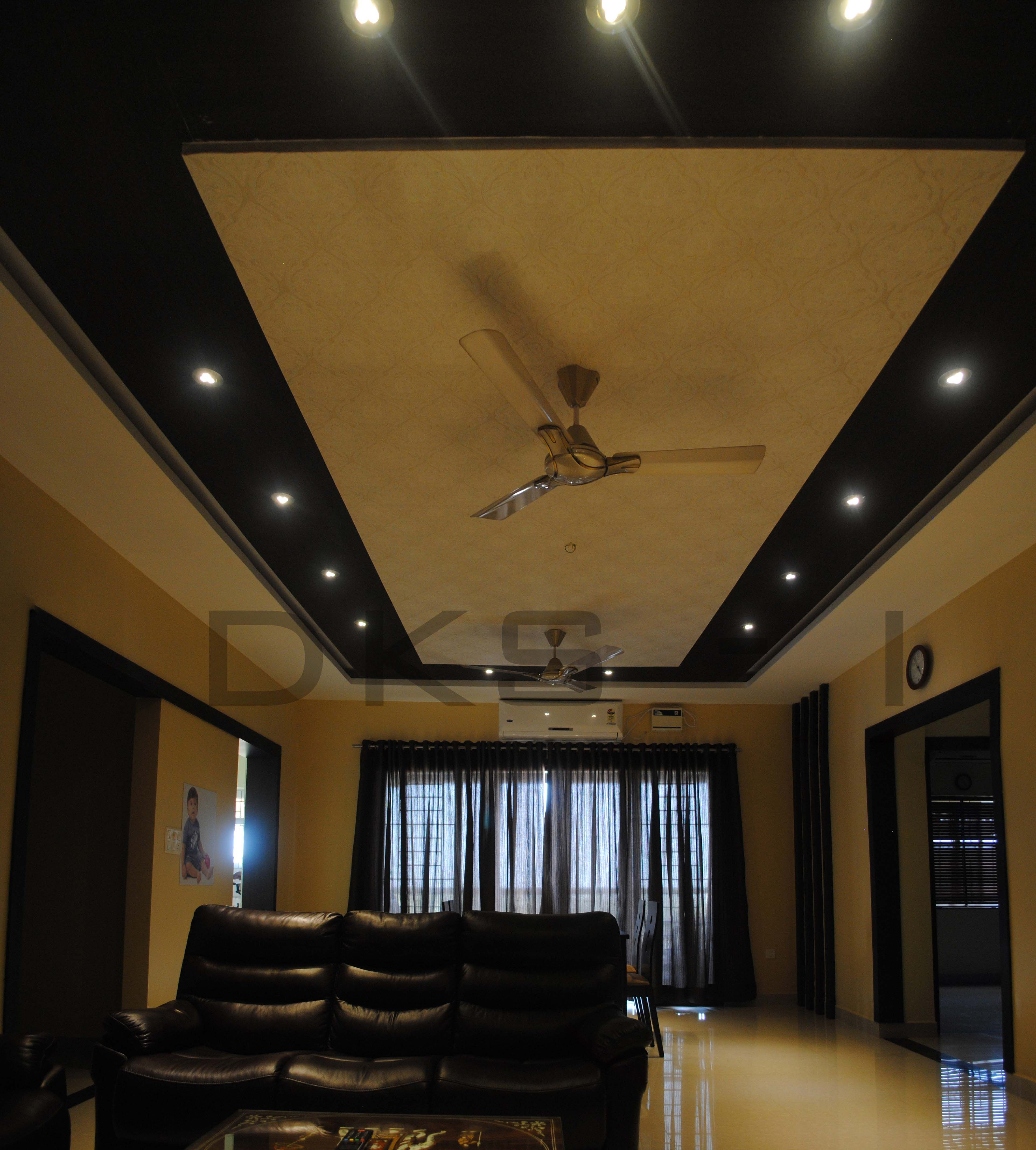 Living Room with black sofas designed by Karthikeyan ...