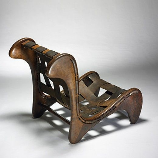 Arthur Espenet Carpenter, Carved Walnut and Leather Lounge Chair, 1961.