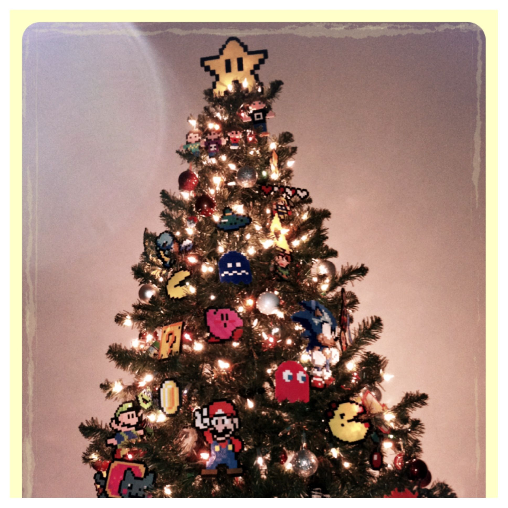 Our 8-bit Christmas tree ornaments made from perler beads. :)