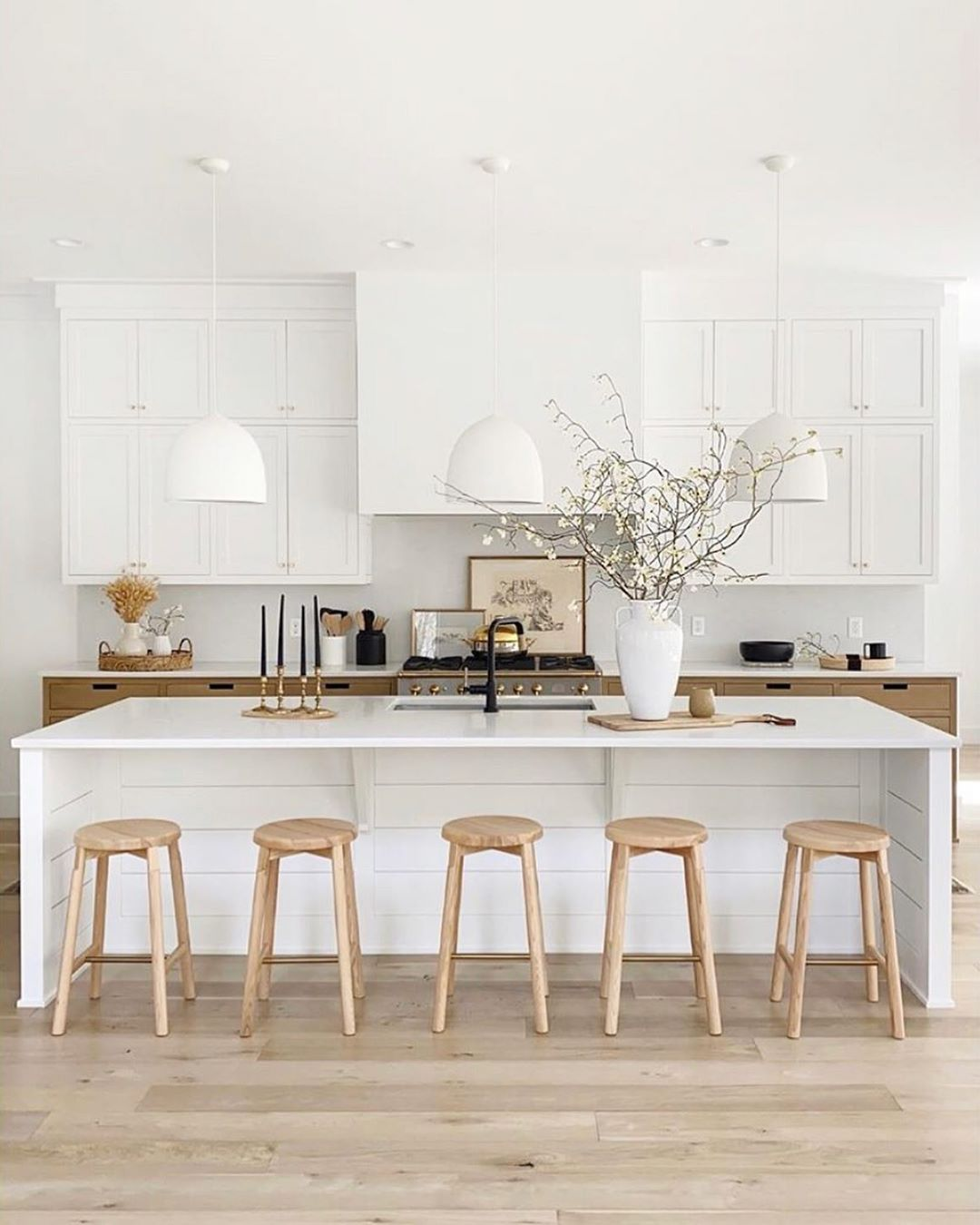 """Juniper Home's Instagram profile post: """"The perfect bright white kitchen with just the right amount of warmth!! We wouldn't mind cooking dinner there every night! Design by…"""""""