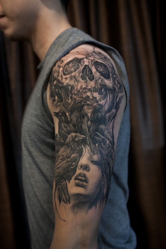 Half Sleeve Black And Grey Crows Skull And Portrait Tattoo