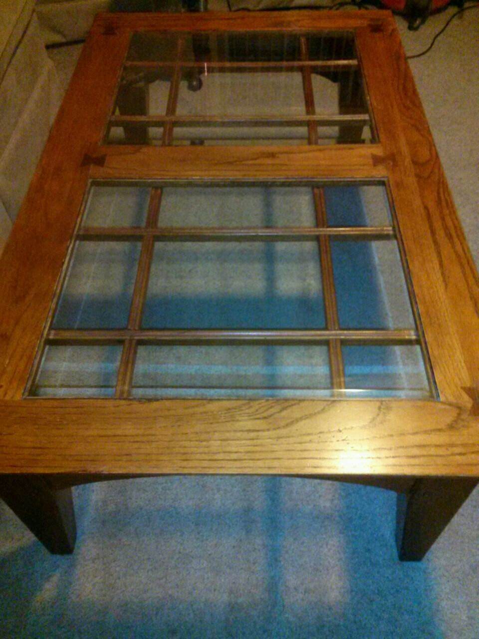 This coffee table has two beveled glass tops that make for a beautiful array of 18 lights. It has wonderful detail on the sides, the tops of the legs, and an almost hourglass shaped wood detail on all of the top and side joined angles. What will I do with this?