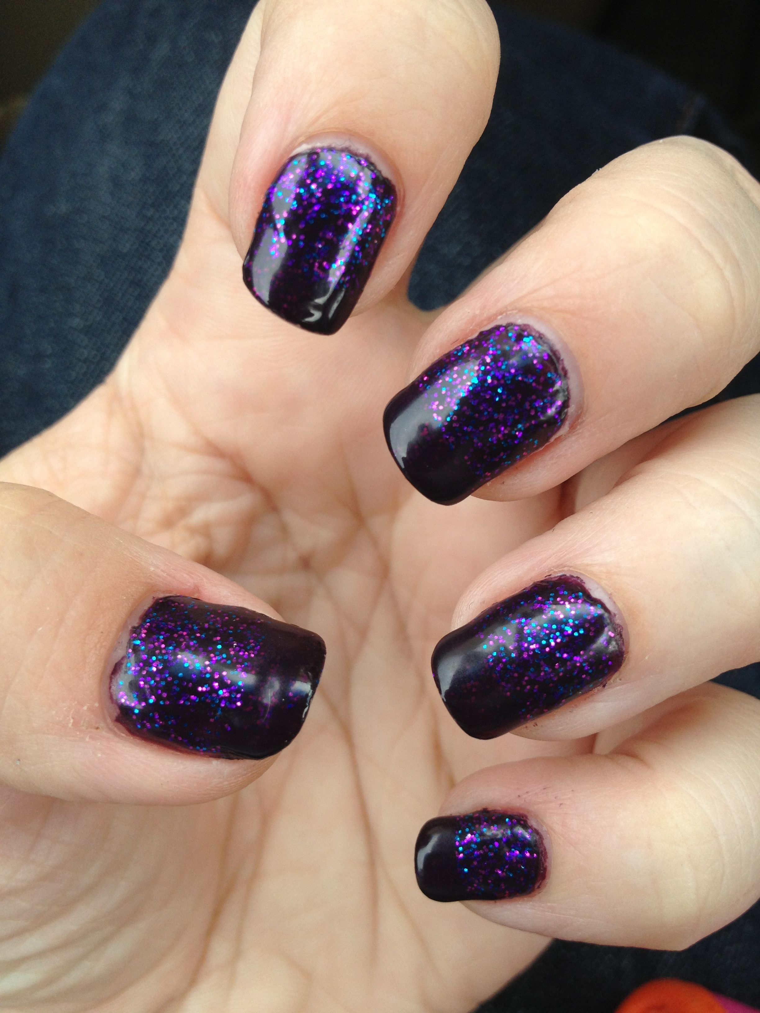 Dark purple nails with purple, pink, blue sparkles with the same ...