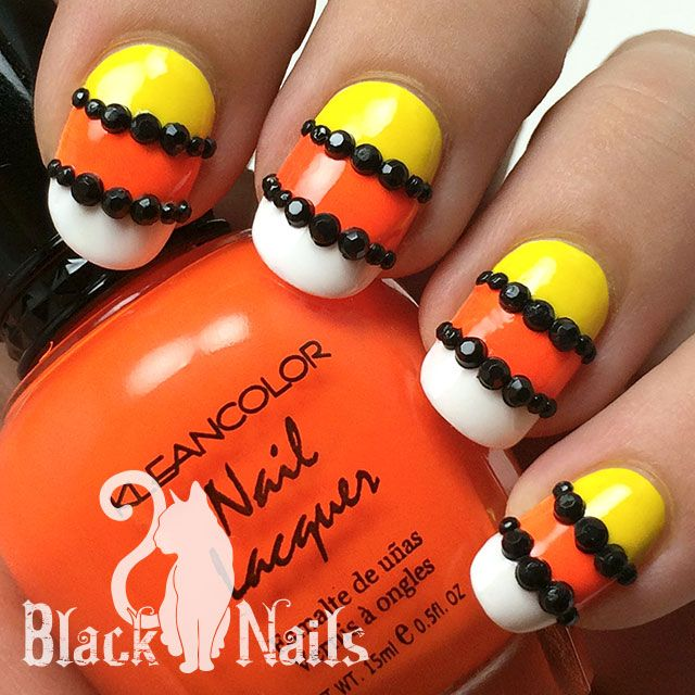 My first Halloween nails of the season, yay! These are super simple candy  corn inspired nails. - Candy Corn Stripes & Studs Halloween Nails By Black Cat Nails