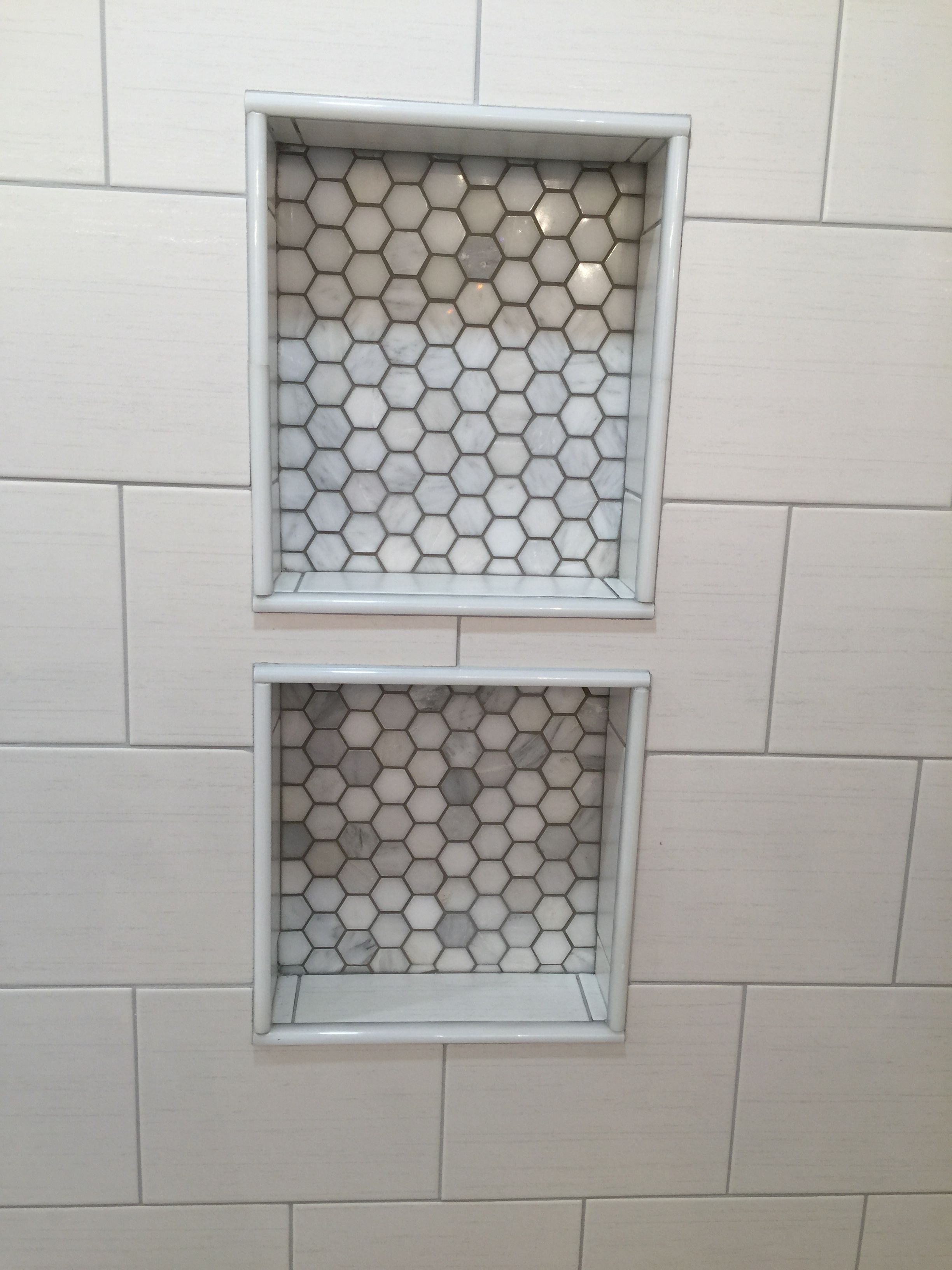 Double niche with Bianco Polished Hexagon Mosaics marble tiles ...