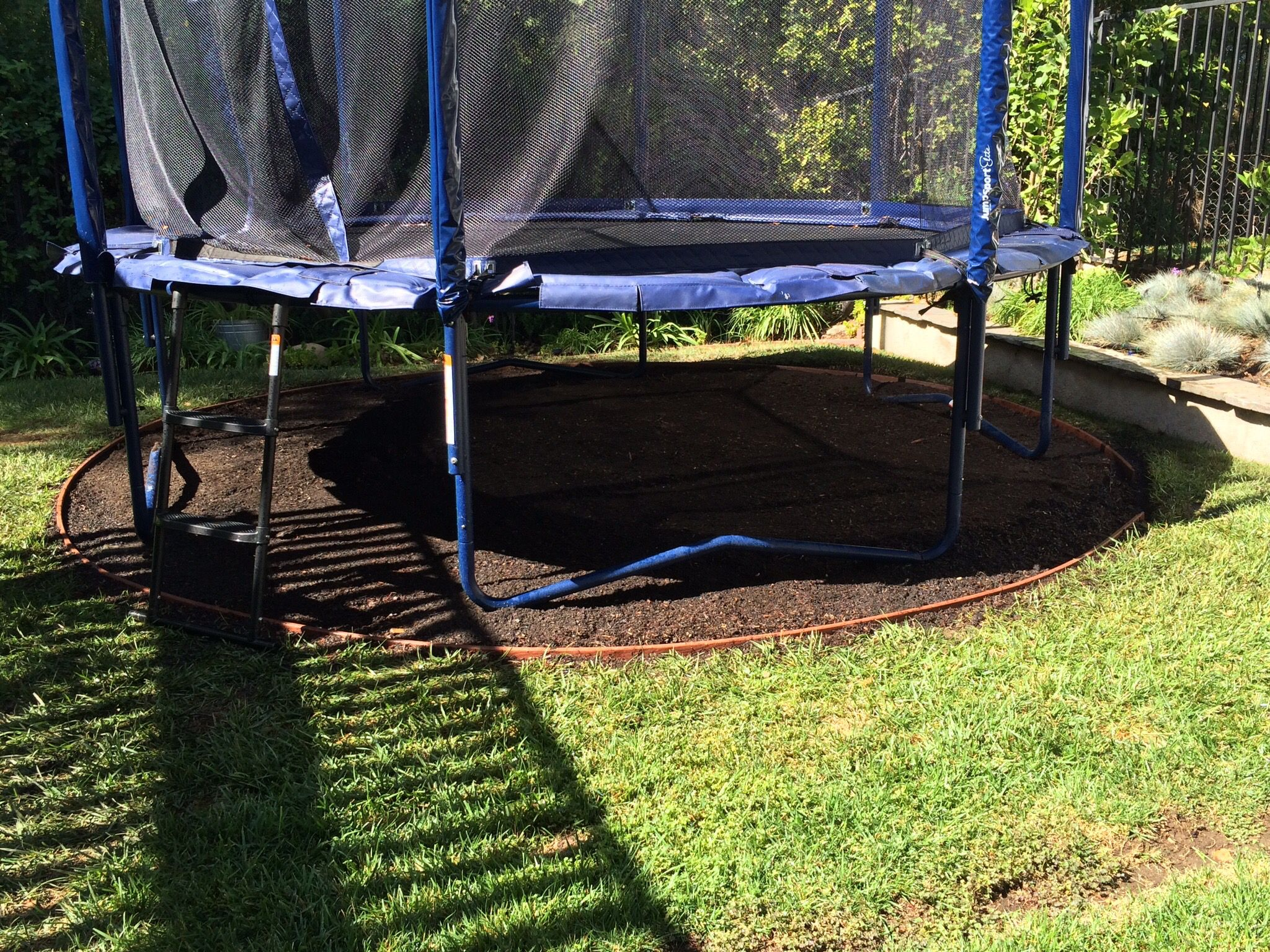 trampoline cut out heavy lifting with turf removal and edging