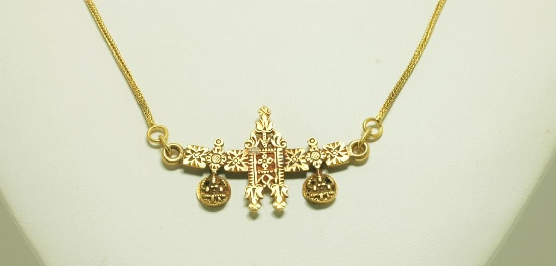 The double-thali, set on a gold pendant and on a traditional gold ...