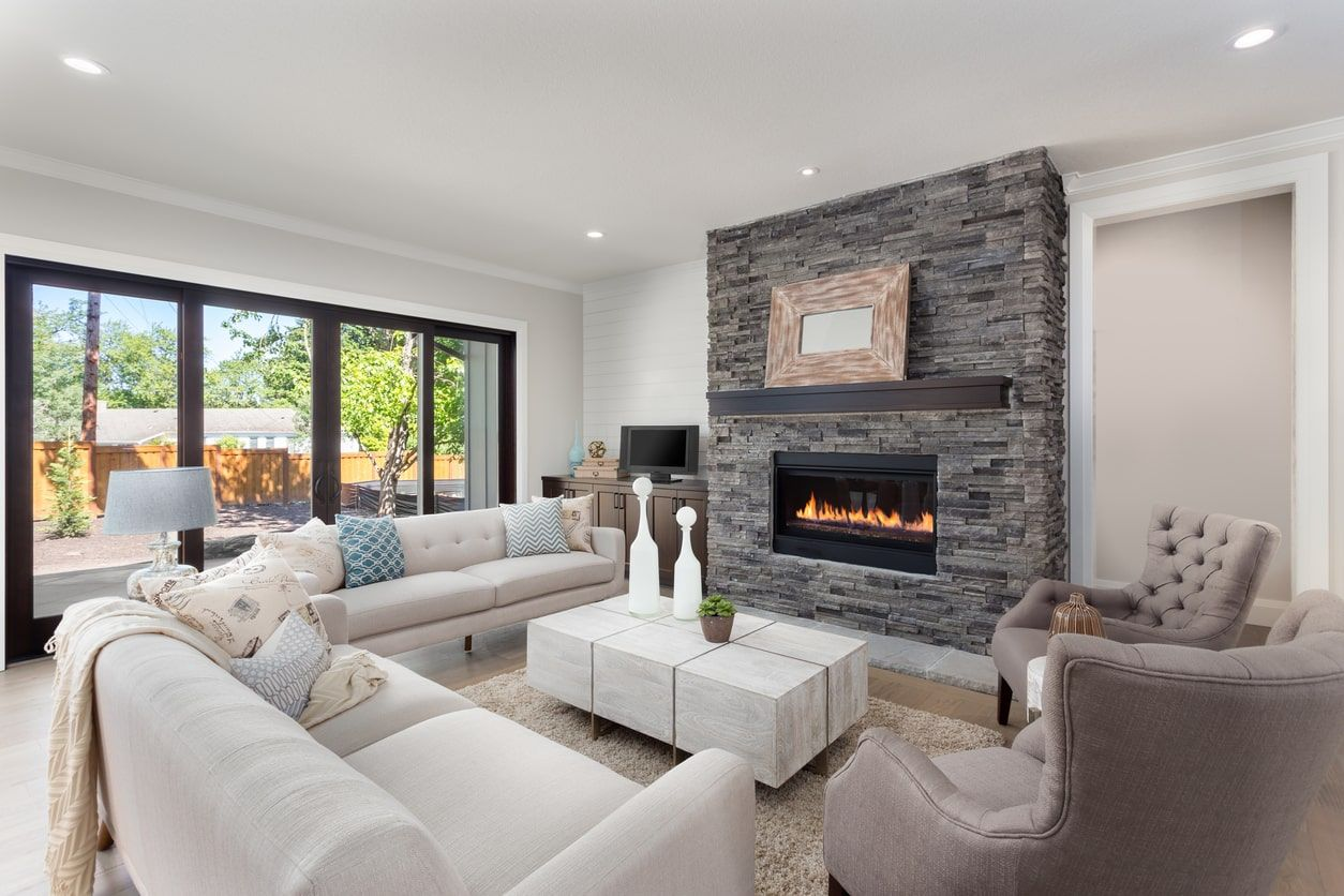 Large Living Room With A Stylish Fireplace The Comfortable And Classy Sofa Set Is Just Gl Beige Living Rooms Living Room With Fireplace Beautiful Living Rooms Fireplace for living room