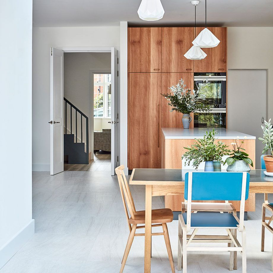 Retro plywood kitchen makeover with blue doors and Corian