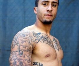 colin kaepernick tattoos what do they say