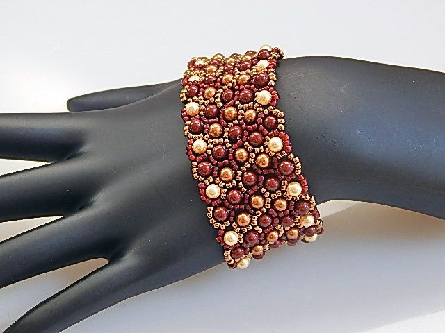 This bracelet is 6.5 inches long and an inch wide. I used Netting stitch with size 11 seed beads and Swarovski crystal pearls in red and cream colors. Its
