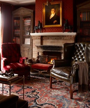 Impeccable style.....love the red wall, leather chair, rugs, fireplace...everything (The Library of Darin Geise)