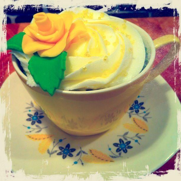 Lemon cupcake displayed in a vintage teacup