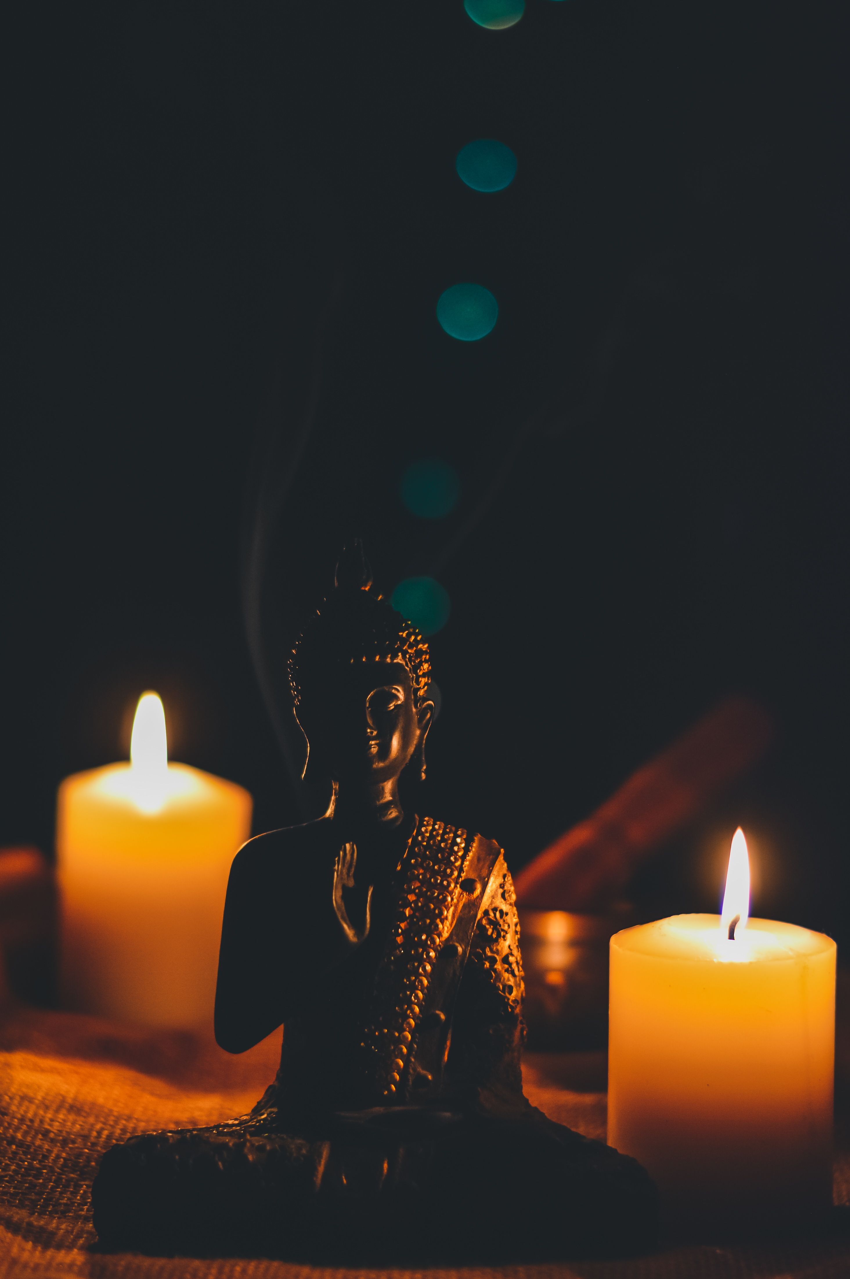 6 Shocking Yoga Portraits Sitting Buddha Beside Pillar Candles #candle #fire #flame