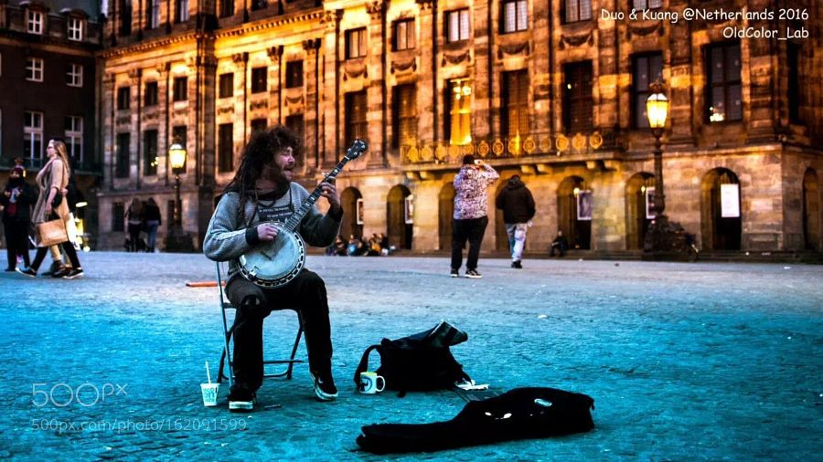 A young man performed Reggea on the Dam-square by oldcolor_studio