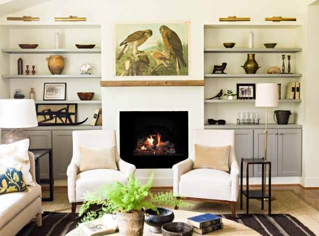 Lauren Liess | Pure Style Home | The natural woods, the vintage kilim layered over the seagrass rug, the linens, the velvet, the vintage bird chart above the fireplace, the collection of quirky antique and vintage objects on the shelves... all of my favorite things.