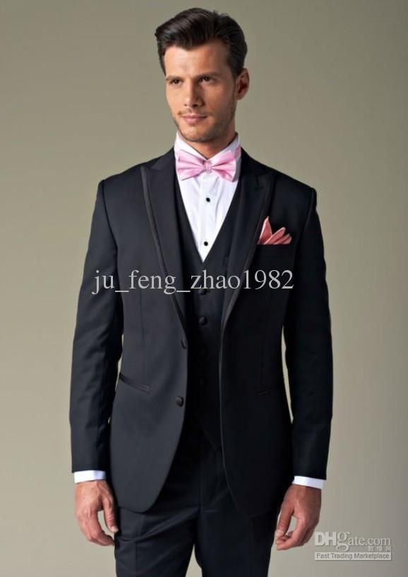 black suit pink bow tie