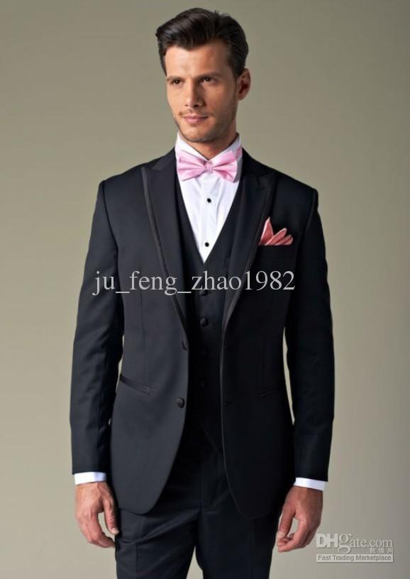 black suit pink bow tie