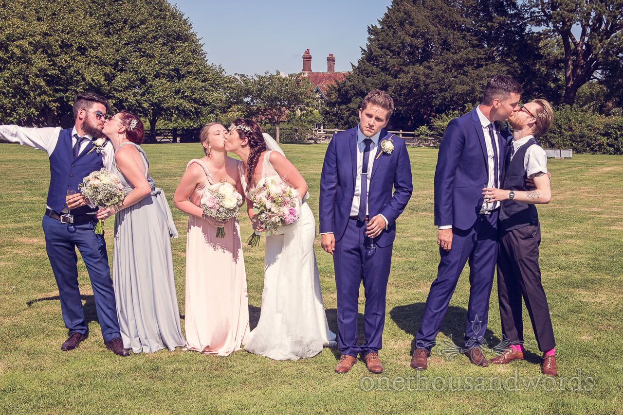 Funny Wedding Group Photograph Kissing Photography By One Thousand Words Photographers