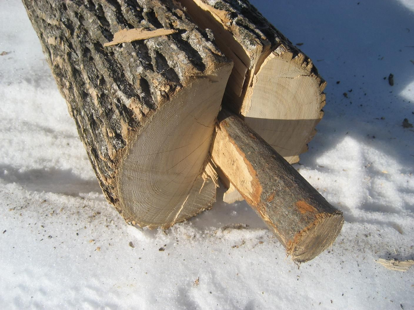 Cutting logs into planks under sink basin cabinet
