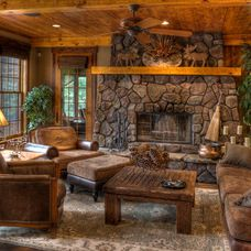 rustic family room by Lands End Development - Designers & Builders