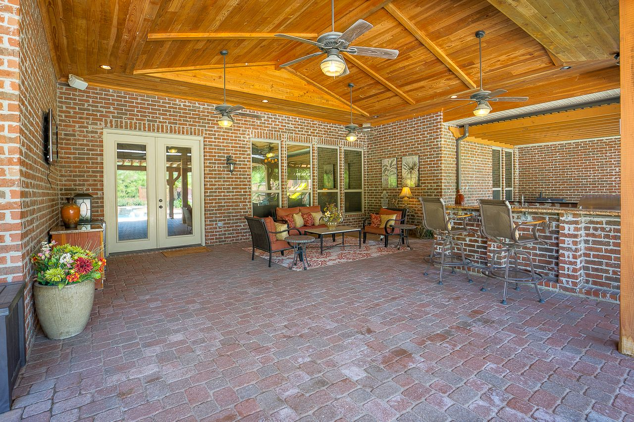 The Exterior Of The Home Is An Entertainer S Delight Come Relax Under A 1300 Sq Ft Covered Patio Outdoor Kitchen Appliances Outdoor Appliances Outdoor Kitchen