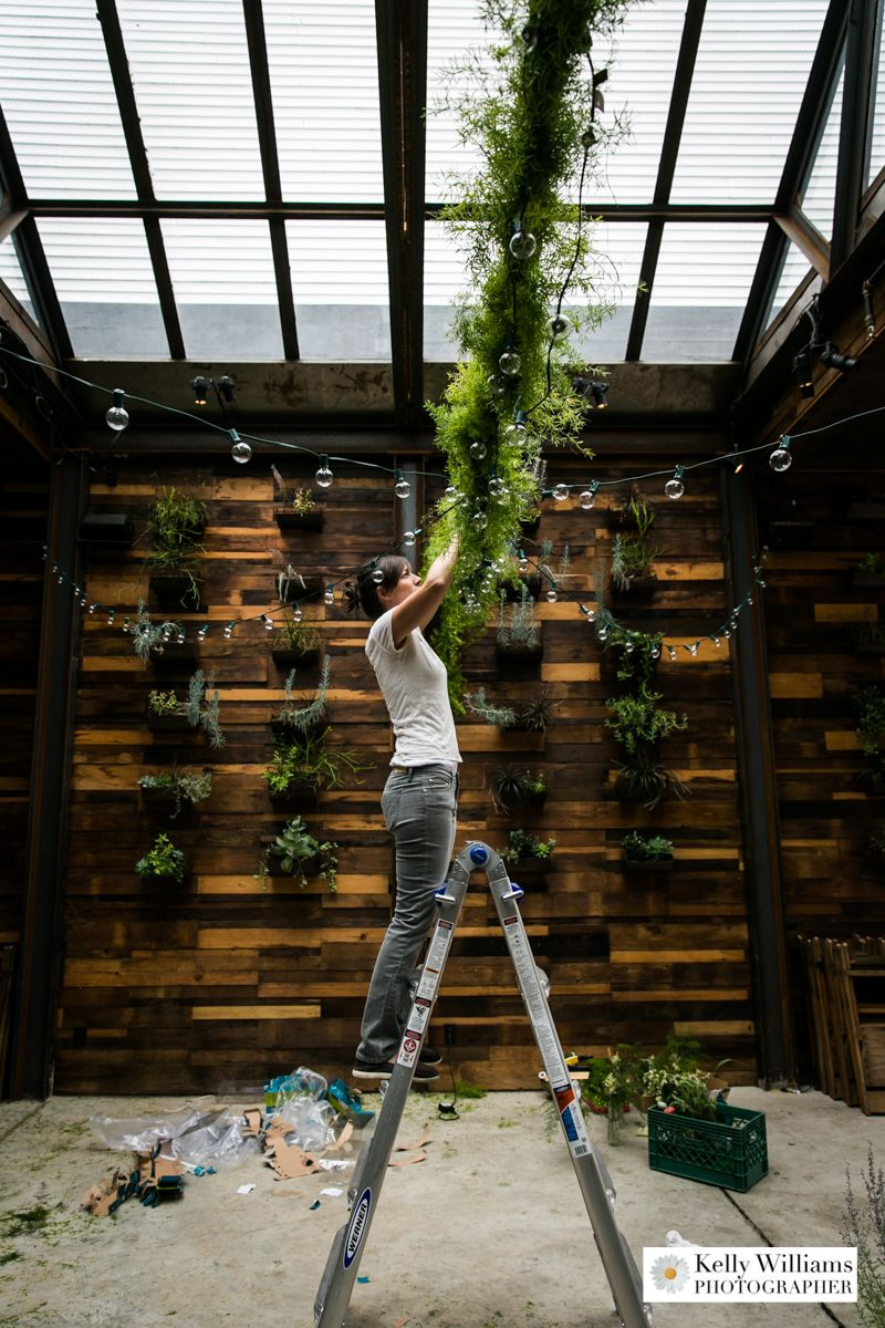 Rebecca of Greenery NYC building a floral garland and