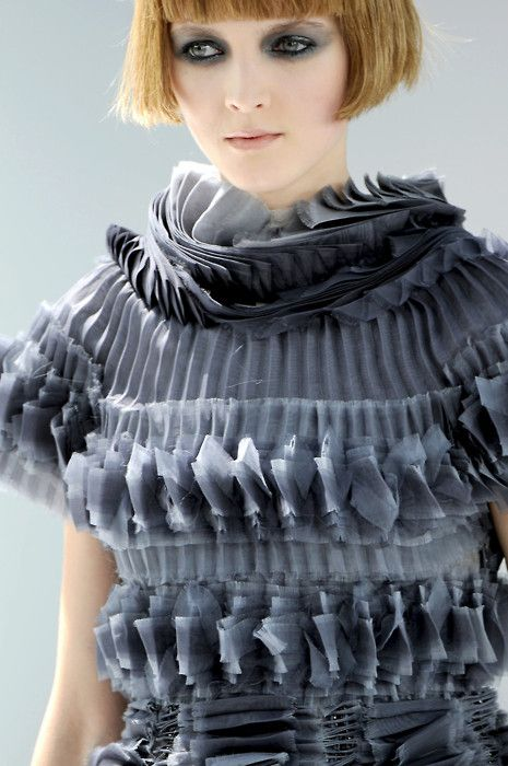 chanel haute couture. layering of pleats and ruffles all over the body