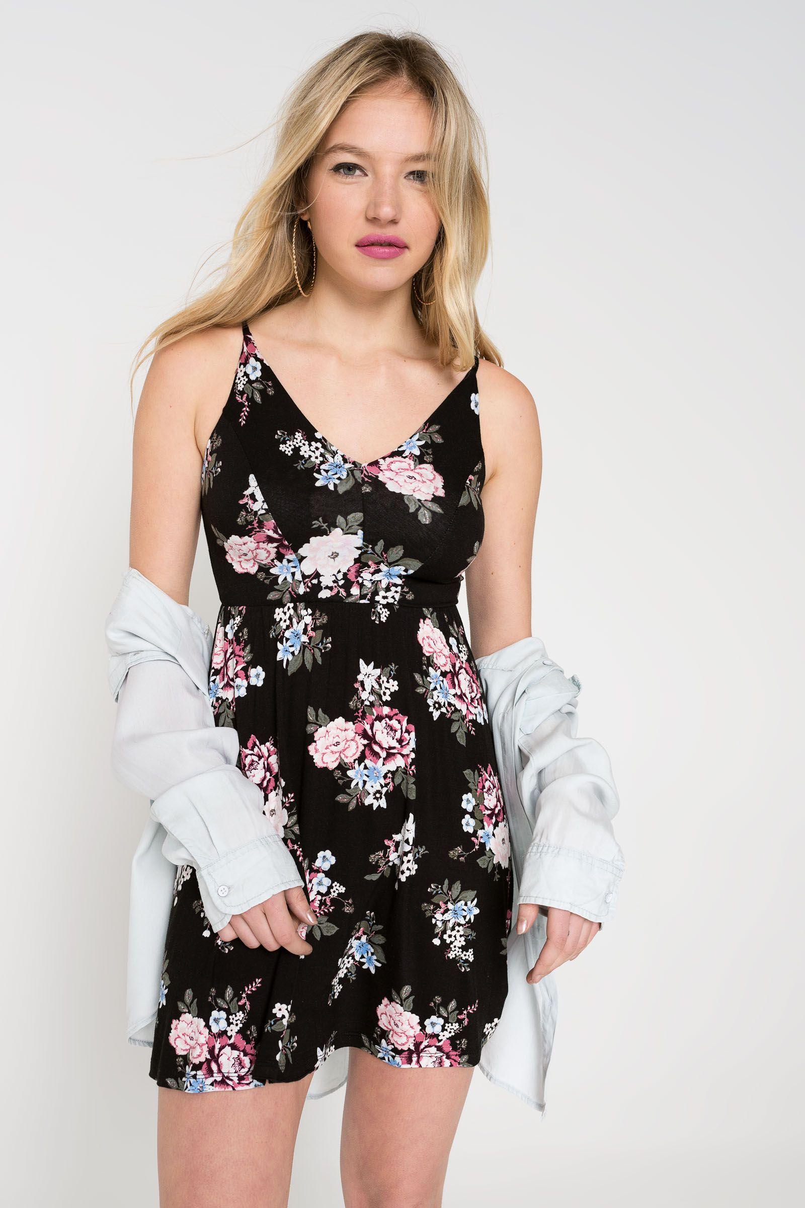 901c1299533fec V-neck mini dress. Adjustable spaghetti straps. Elastic seam at waist. 95%  viscose