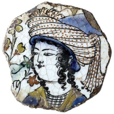 Tile about 1575-1600 Turkish (Iznik) The Iznik tiles of the second half of the sixteenth century are justly famous for their bright tomato-red color, which together with black, blue, turquoise, and green were painted in underglaze colors on the flawless white ground.