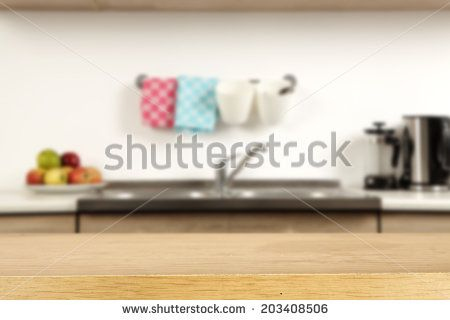 empty wooden desk of yellow and kitchen space  - stock photo