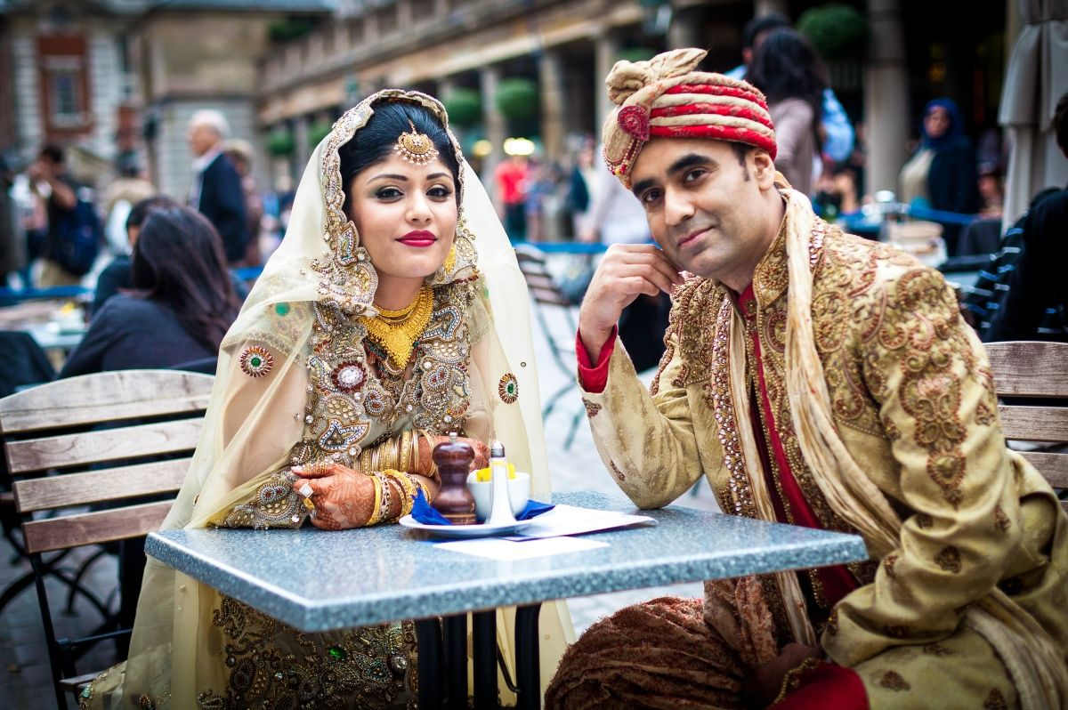 Muslim wedding couple in traditional islamic outfit man wearing a