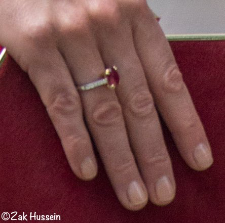 The Duchess debuted a striking new pendant and matching earrings. Unusually, Kate also wore a ring (apart from her wedding rings). It looks like they are rubies and diamonds.