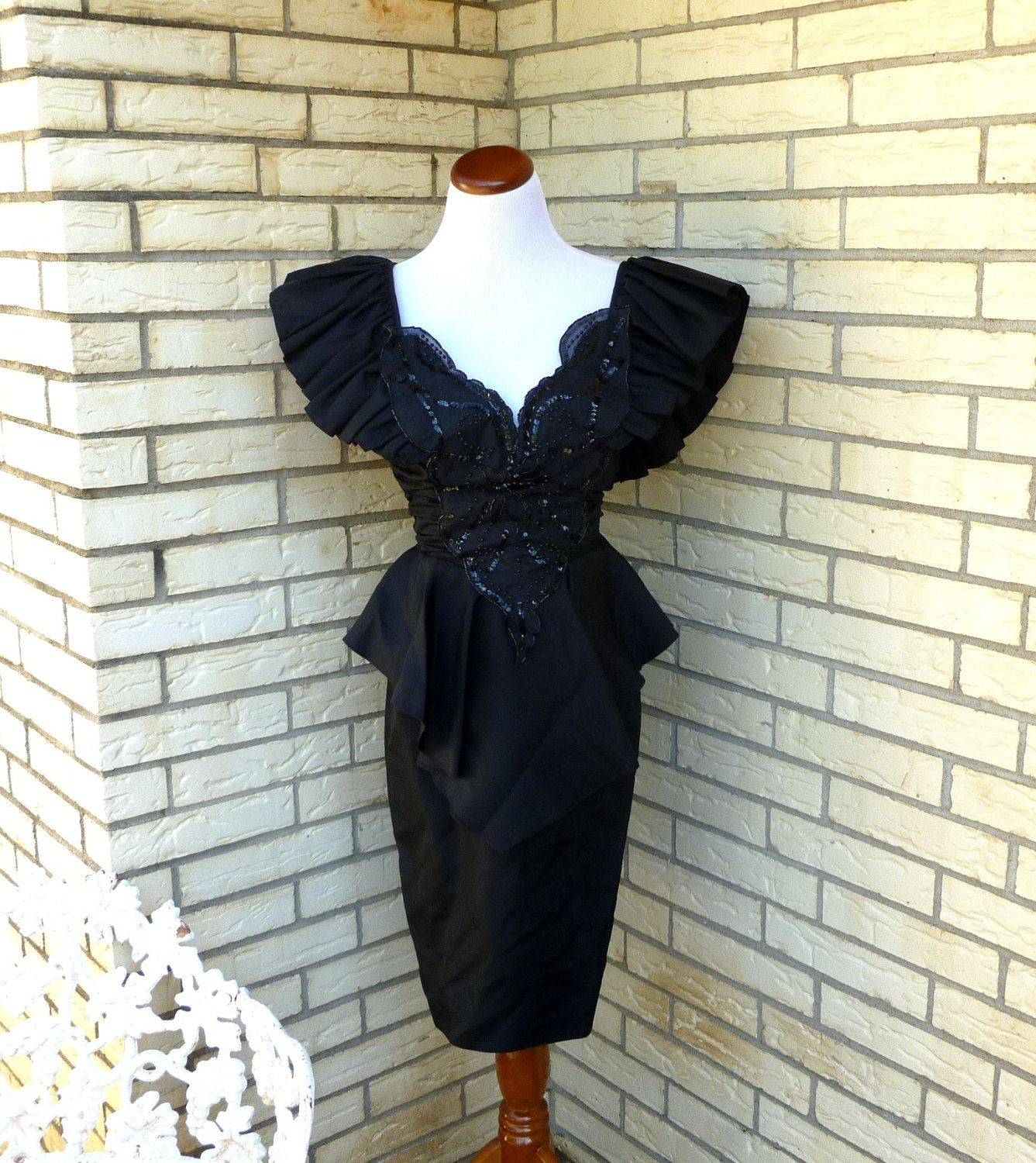 S black prom dress plunging neckline fit and flare nipped waist