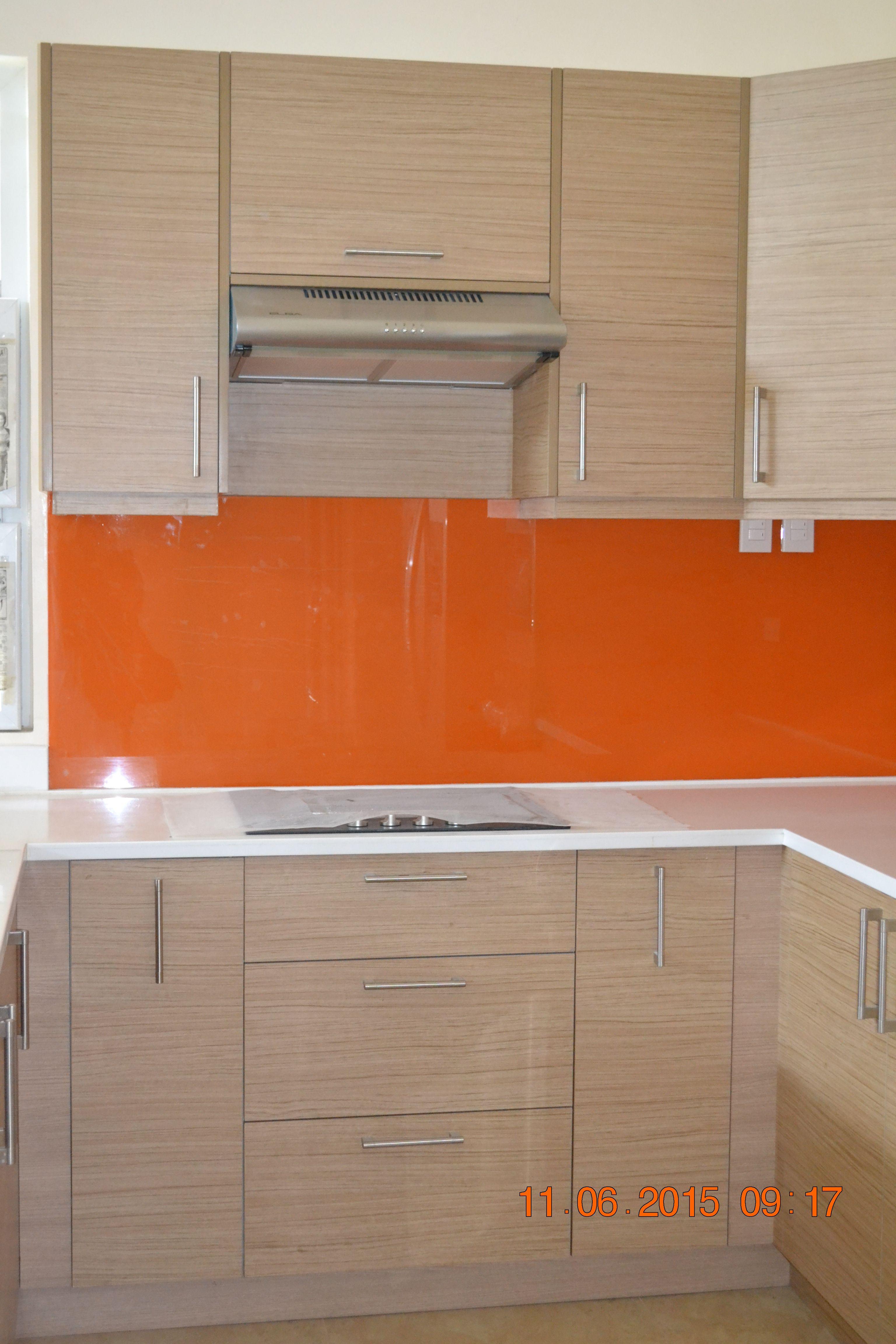Melamine Woodgrain Royal Oak Finish With Graphicoat Orange Backsplash Nuestone White Granite Count Modular Kitchen Cabinets Kitchen Upgrades Kitchen Cabinets