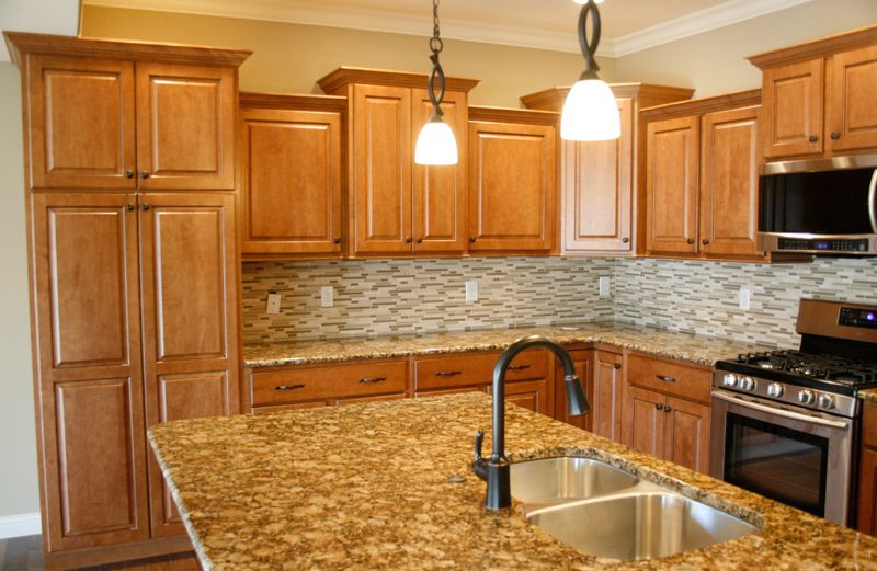 maple kitchen cabinets with granite countertops | Maple ... on What Color Granite Goes With Honey Maple Cabinets  id=42536