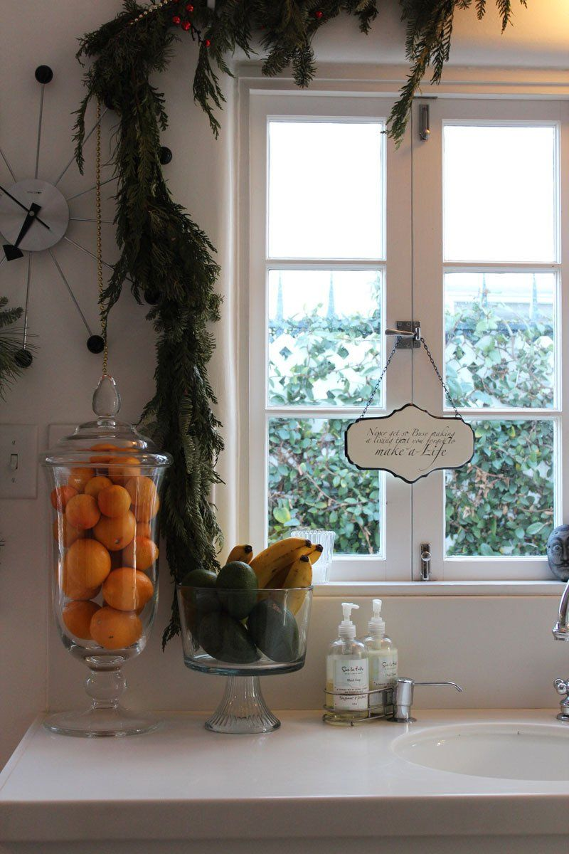 Adrianna & Paul's Eclectic Perfection Home - love the oranges in a lidded glass jar.