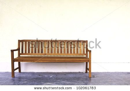 stock photo : wood Bench Against blank Wall.