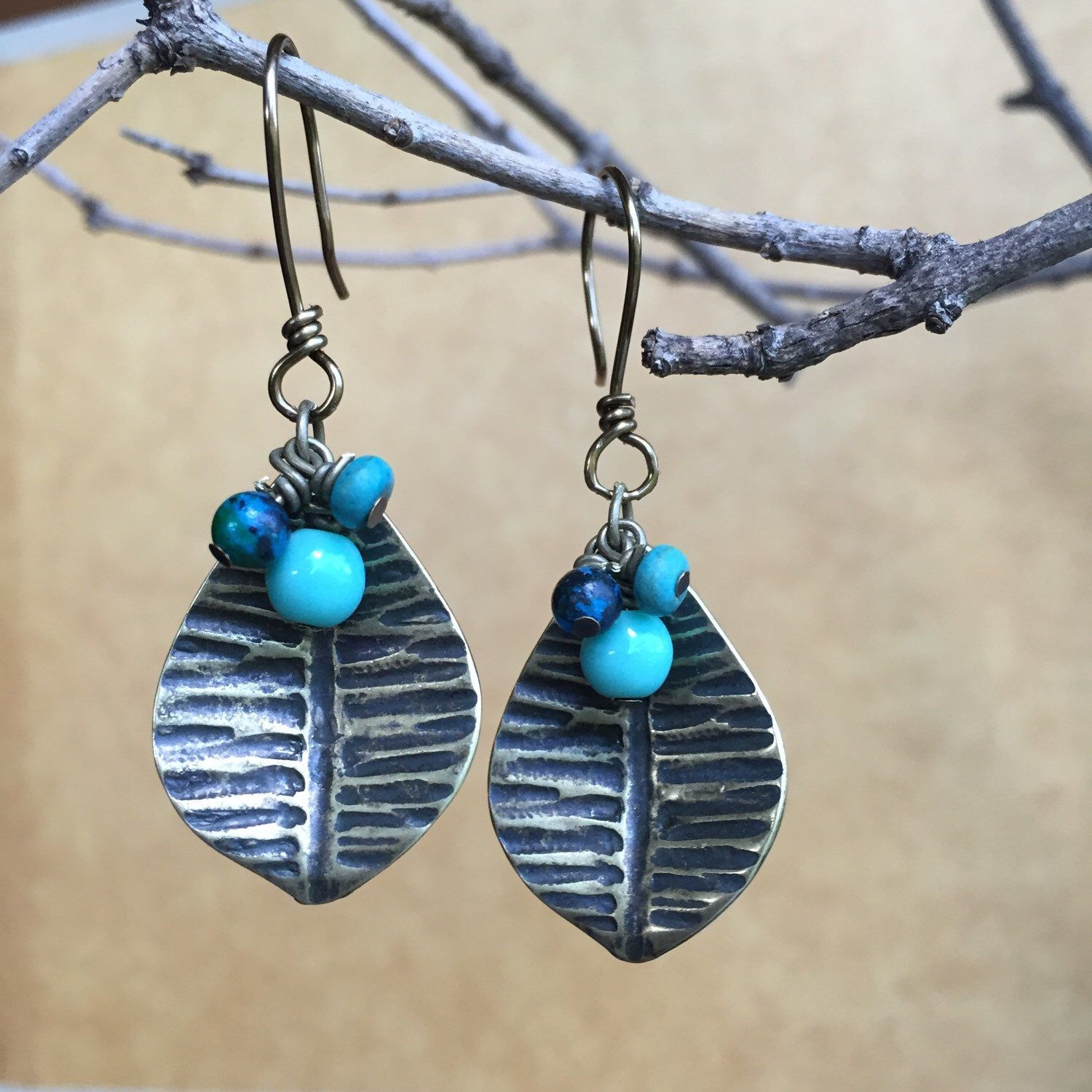 A personal favorite from my Etsy shop https://www.etsy.com/listing/252075993/blue-and-golg-leaf-drop-earrings