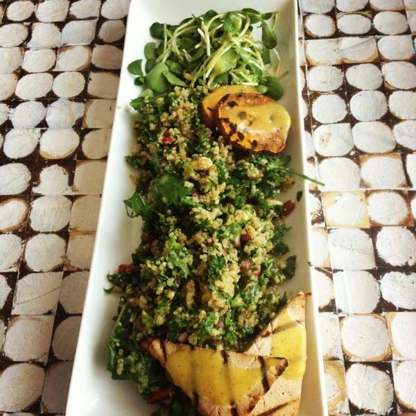 Wow! @estherkatzman's quinoa, tabbouleh, kale, goji berry, toasted nuts/seeds, parsley, cilantro, sweet potato and tofu salad! Clean and beautiful!