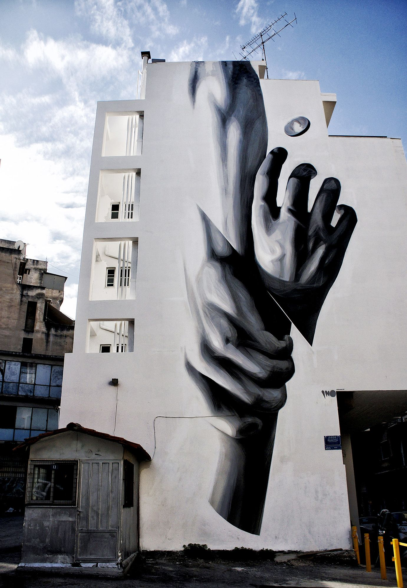 Walls are adorned with works of contemporary graffiti on the streets ...