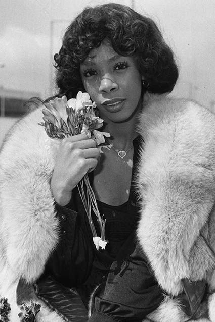 Donna Summer arrives at Heathrow Airport for a three-day visit to London on April 26, 1976.