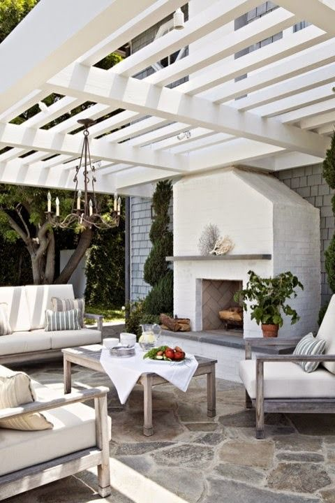 Elegant allwhite outdoor living room with whitewashed wood