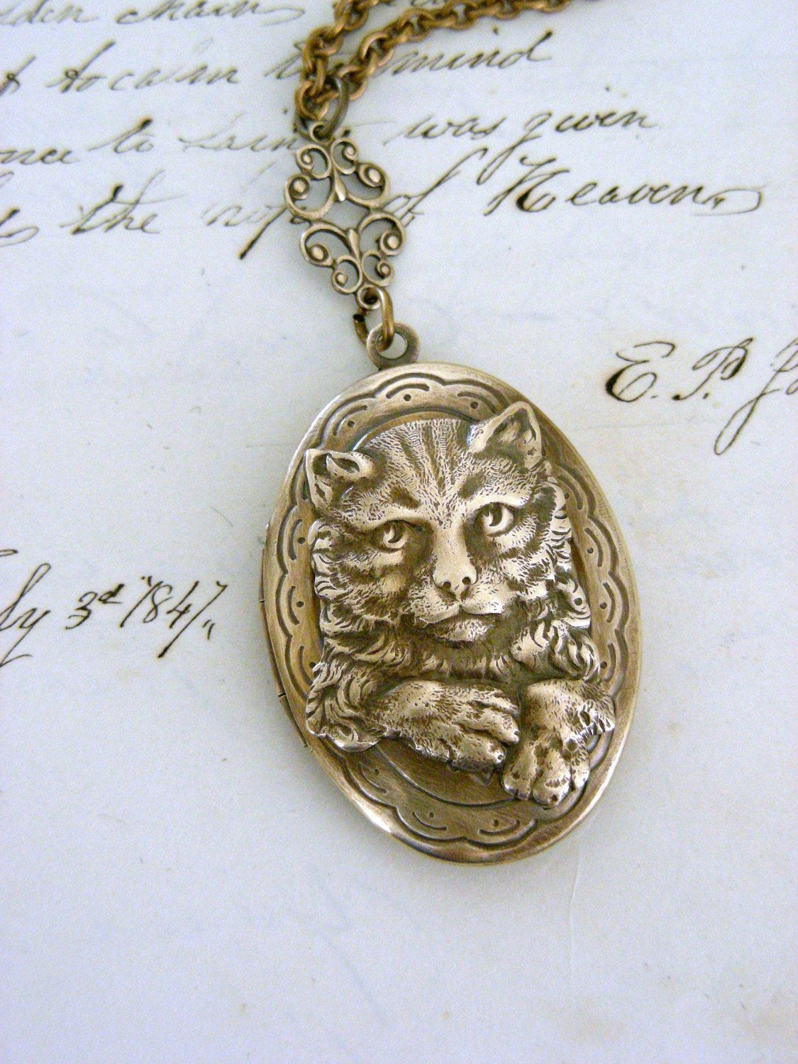Locket Kitty Cat Necklace Retro Vintage Locket Handmade Brass Necklace. $35.00, via Etsy.