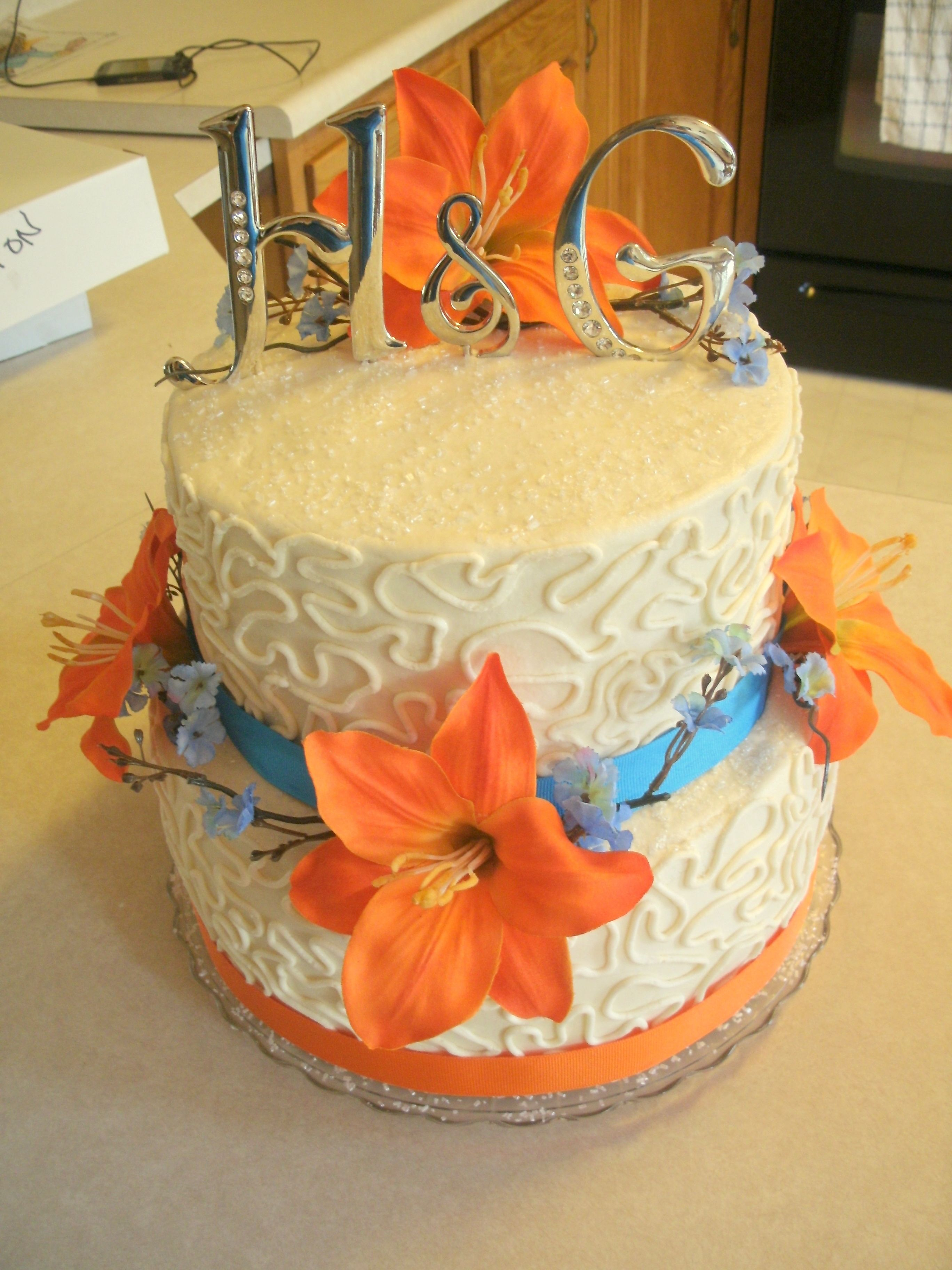 Blue and Orange themed wedding cake! 2 tier stacked with real ribbon ...
