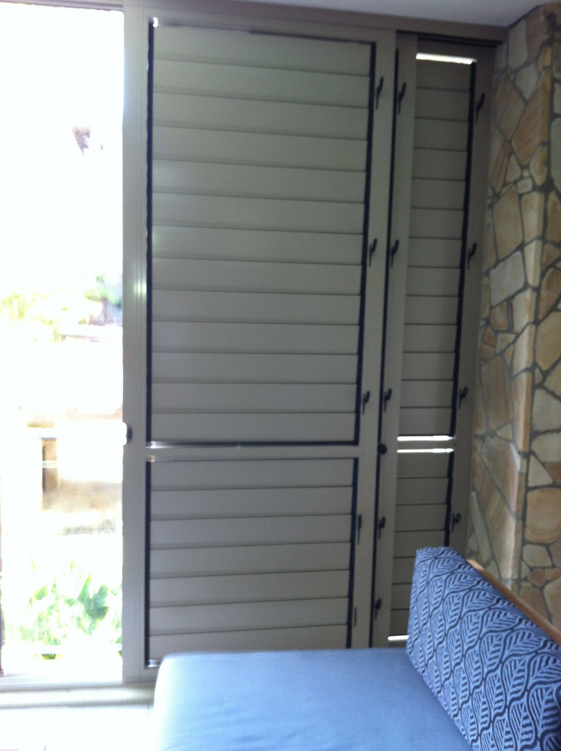 Outdoor plantation shutters bi fold option closed for privacy