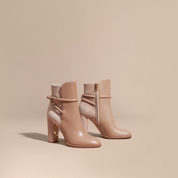 0aac552b5a9d All-occasion ankle boots with a slim wraparound belt. Panels of smooth  leather and suede add subtle textural interest