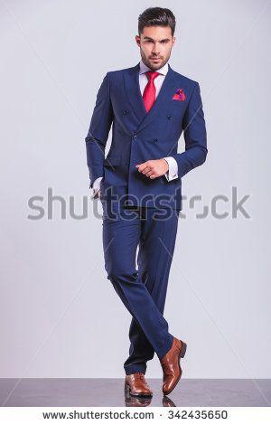full body portrait of handsome business man posing ...