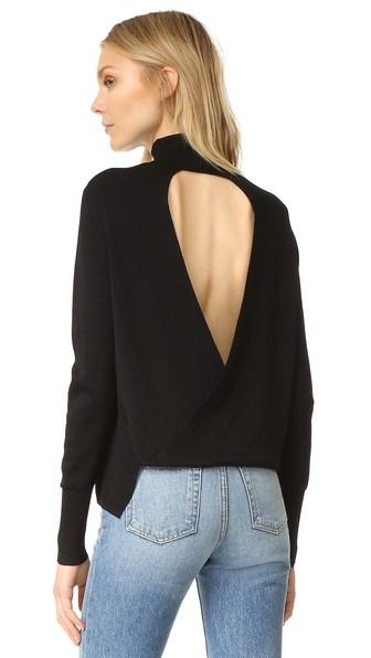 ebefcd8d8e This lightweight mock-neck sweater is styled with a crossover back. Ribbed  edges and long sleeves.