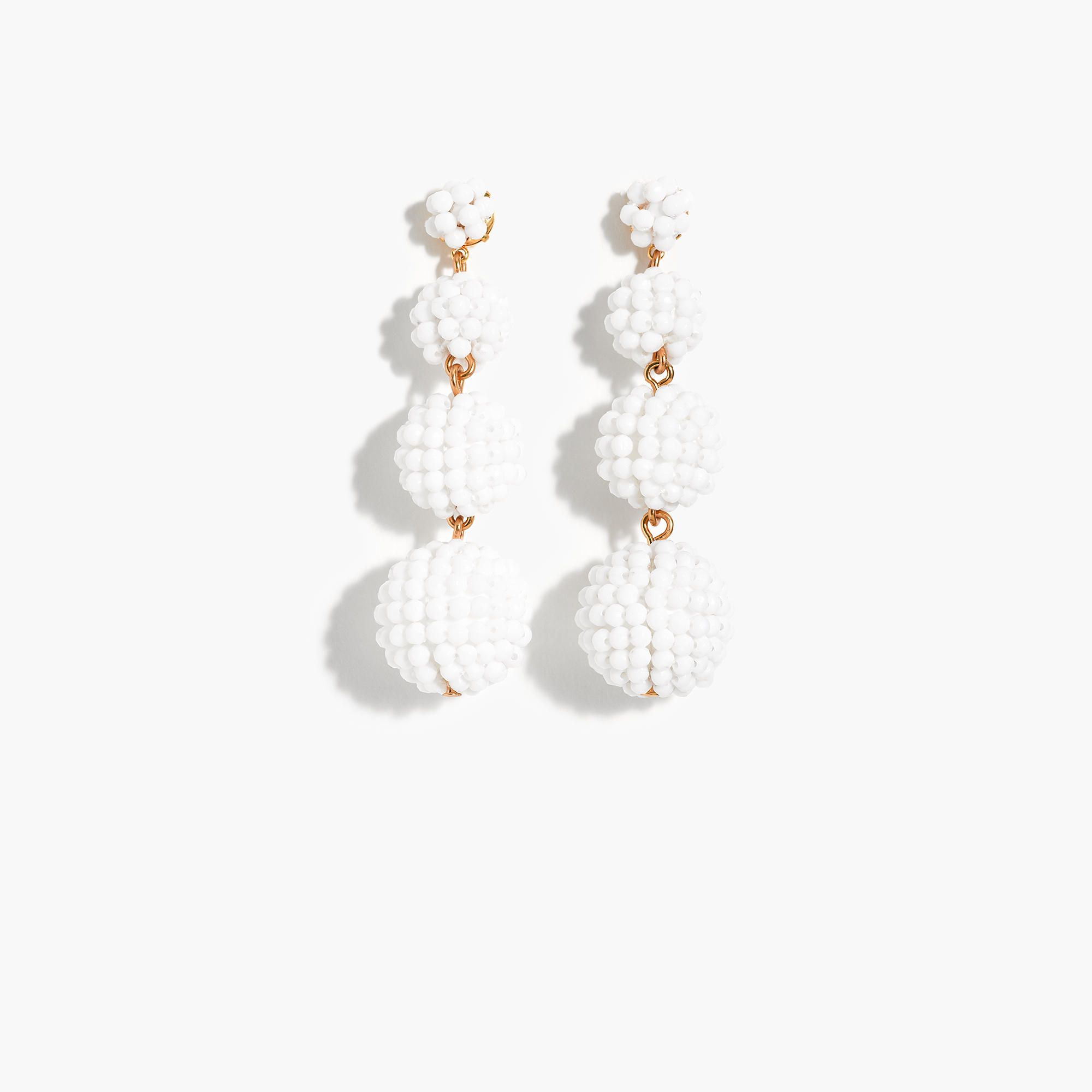 o earrings round with off white necklace beaded